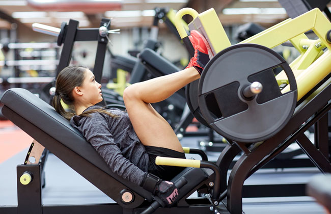 Image of woman doing a leg press